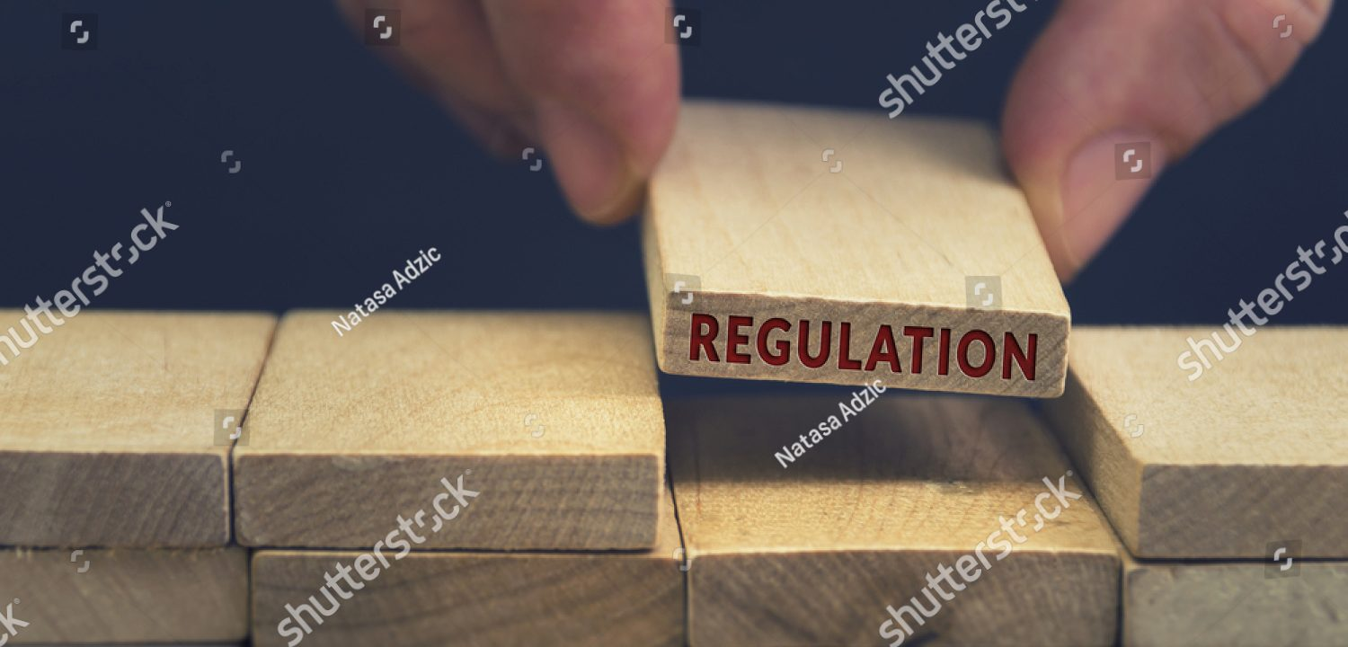 stock-photo-regulation-word-written-on-wooden-block-713866822